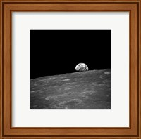 Framed first photograph taken by humans of Earthrise during Apollo 8.
