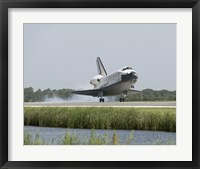 Framed Space Shuttle Endeavour touches down on the runway