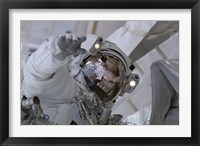 Framed Astronaut Participates in a Session of Extravehicular Activity 3