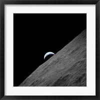 Framed crescent Earth Rises above the Lunar Horizon