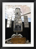 Framed Hubble Space Telescope is Released from the Cargo Bay of Space Shuttle Atlantis