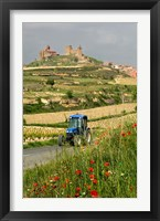 Framed Blue tractor on rural road, San Vicente de la Sonsierra Village, La Rioja, Spain