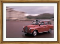 Framed Cab racing past Buckingham Palace, London, England