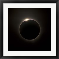 Framed Solar Eclipse with prominences and diamond ring effect