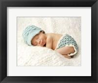 Baby In Light Blue Framed Print