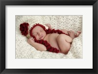 Baby In Red And White Framed Print