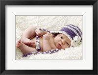 Baby In Lavender And White Cap Framed Print