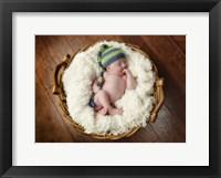 Basket Baby Framed Print