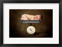 Baby On Scale Framed Print