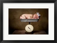 Baby Resting On Scale Framed Print