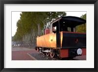 Framed Train Display along Riverbank