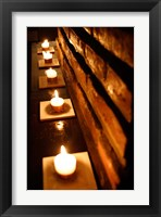 Framed Lighted Candles and Brick Wall