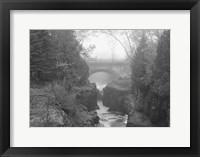 Framed Bridge Over Rocks Black And White