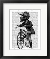 Triceratops Man on Bike Dinosaur Framed Print