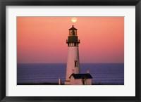 Framed Tall Lighttower Against the Ocean