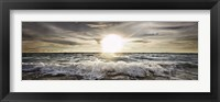 Framed Sun Shining over Rocky Waves