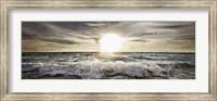 Framed Sun Shining over Rocky Waves
