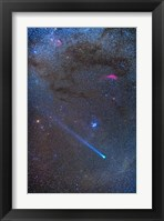 Framed Comet Lovejoy's long ion tail in Taurus