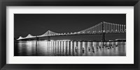 Framed Bay Bridge lit up at night, San Francisco, California