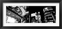 Framed Low angle view of buildings lit up at night, Tokyo, Japan