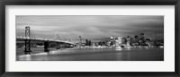 Framed Bay Bridge lit up at dusk, San Francisco, California