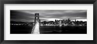 Framed Bridge lit up at dusk, Bay Bridge, San Francisco, California