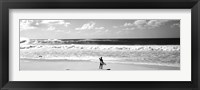 Framed Surfer standing on the beach, North Shore, Oahu, Hawaii BW