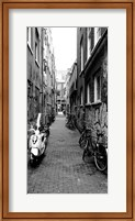 Framed Scooters and bicycles parked in a street, Amsterdam, Netherlands