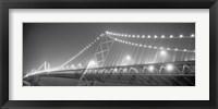 Framed Suspension bridge lit up at night, Bay Bridge, San Francisco, California