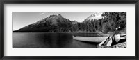 Framed Canoe in lake in front of mountains, Leigh Lake, Rockchuck Peak, Teton Range, Wyoming