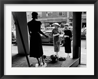 Framed Women Looking at Window Display