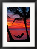Framed Woman in hammock, and palm trees at sunset, Fiji