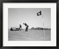 Framed 1960s Man Playing Golf Putting