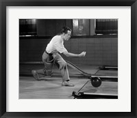 Framed 1950s Side View Of Man Bowling