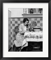 Framed 1920s Woman Sitting At Kitchen Table