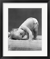 Framed 1940s Baby Bending Down With Head On Blanket