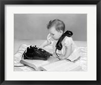 Framed 1960s Baby Girl With Telephone Book