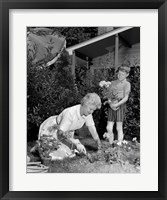 Framed 1960s Boy Helping Grandmother Plant Flowers