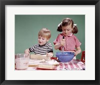 Framed 1960s  Boy And Girl Mixing Ingredients For Cookies