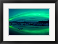 Framed Aurora Borealis or Northern Lights over Jokulsarlon Lagoon, Iceland